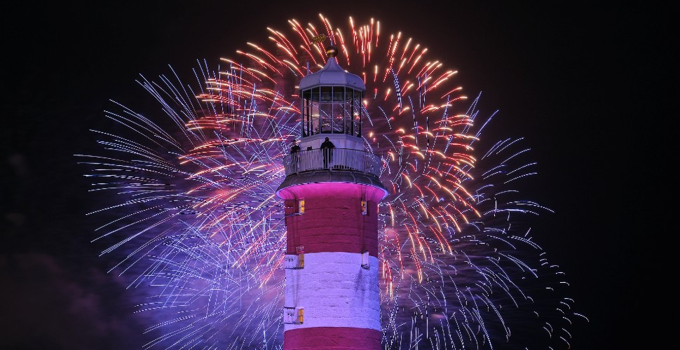 Fireworks behind Smeaton's Tower on Plymouth Hoe