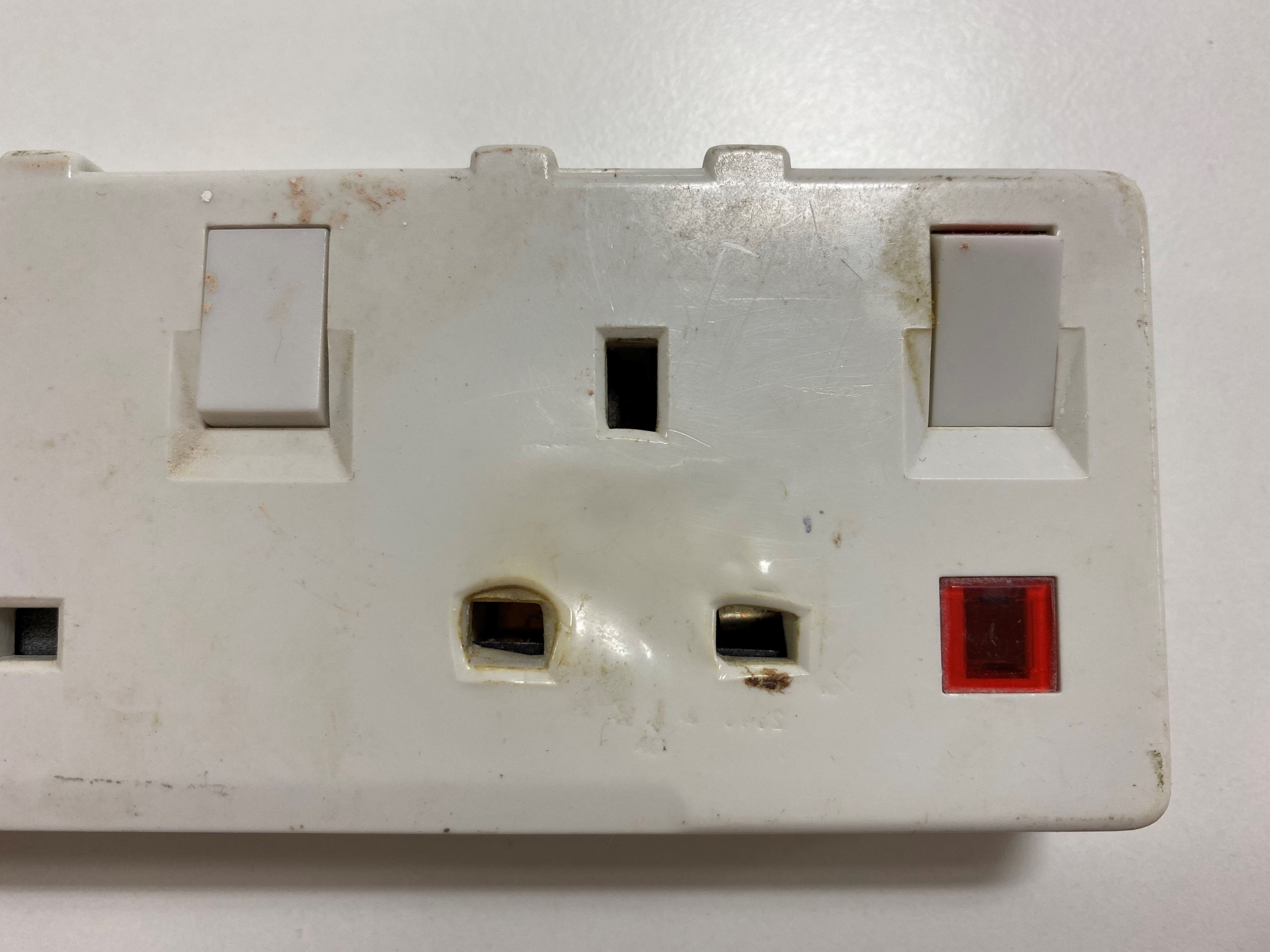 A photo of the damaged socket, caused by the overheating of a commercial tumble dryer