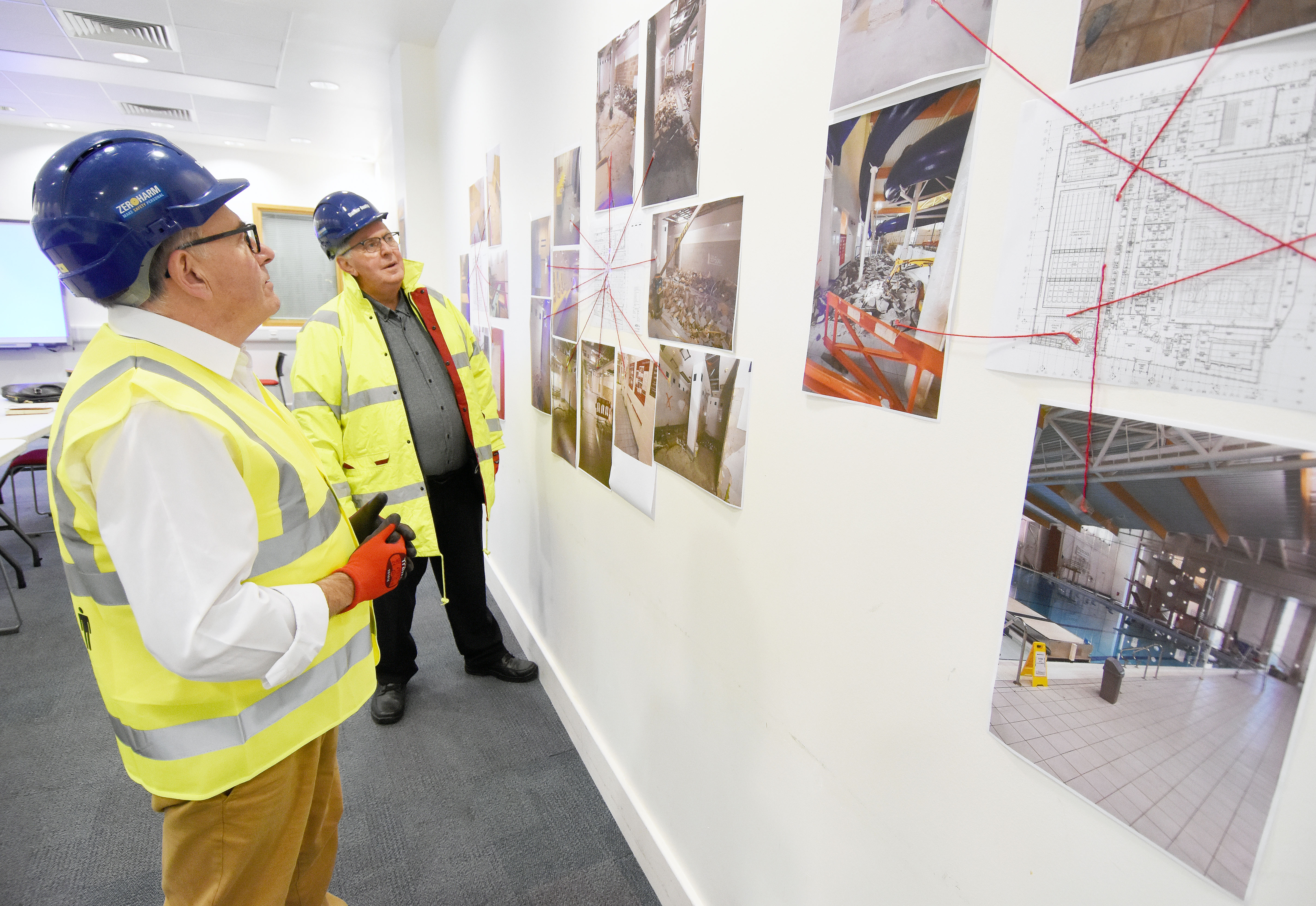Councillor Pete Smith and Tudor Evans looking at the designs