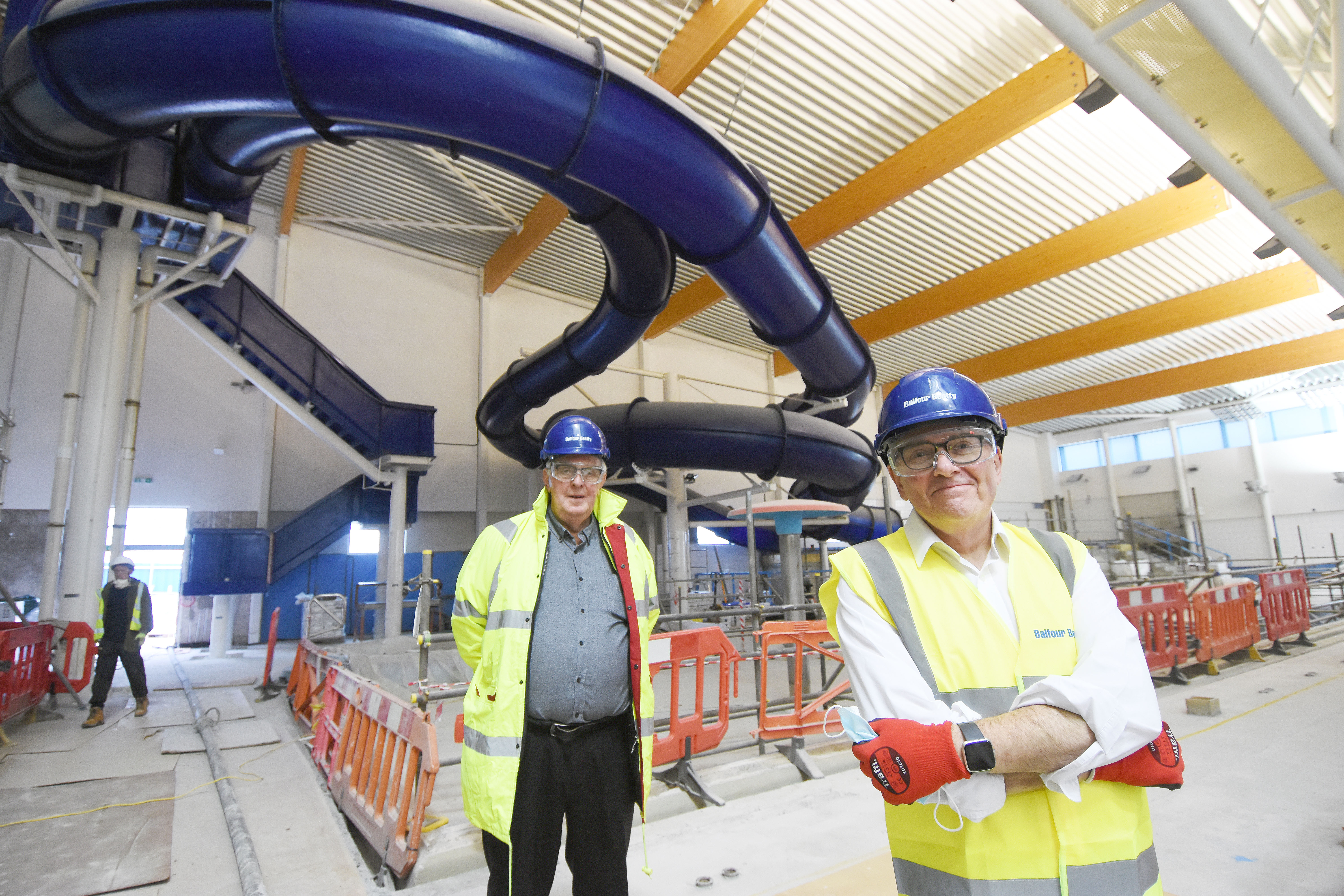 Councillor Tudor Evans and Pete Smith inside the Life Centre in front of the slide