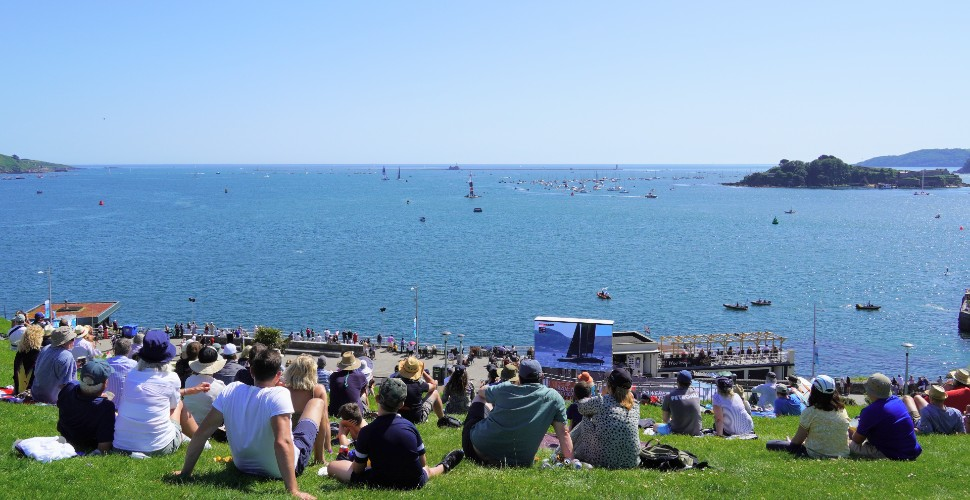 Crowds of people on Plymouth Hoe watching the Great Britain Sail Grand Prix take place in Plymouth Sound
