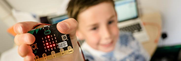Child holding Microbit