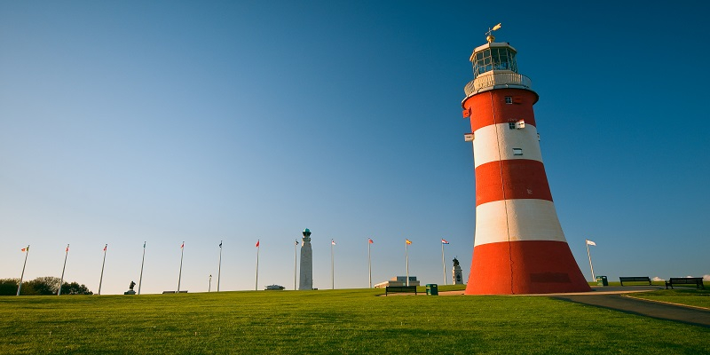 Photograph of Plymouth Hoe with a red and white striped lighthouse
