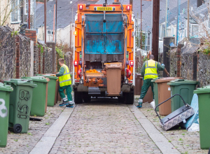A photo of a bin lorry in a back lane