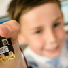 Child holding Microbit