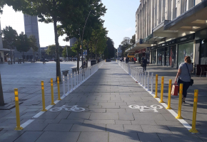 image showing a cycle path with bollards outside shops in Armada Way