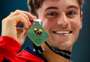 Image of Tom Daley holding a medal