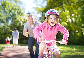 Image of a girl and a man cycling