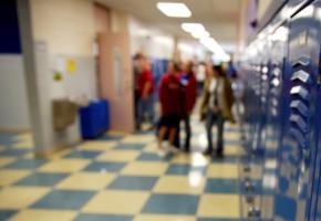 blurred image of children in a school corridor